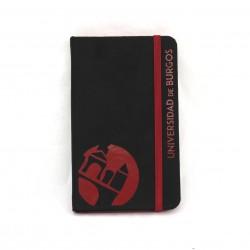 Libreta negra con goma y lomo rojo